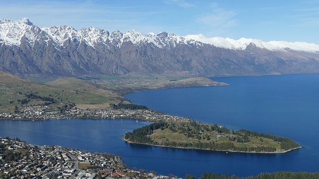 New Zealand South Island: Queenstown and Lake Wakatipu aerial view with mountains on the background